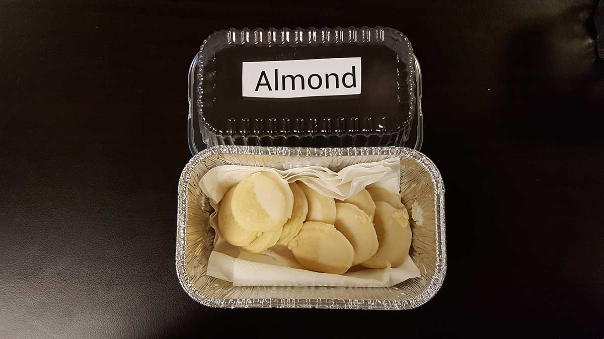 A container of almond flavored cookies