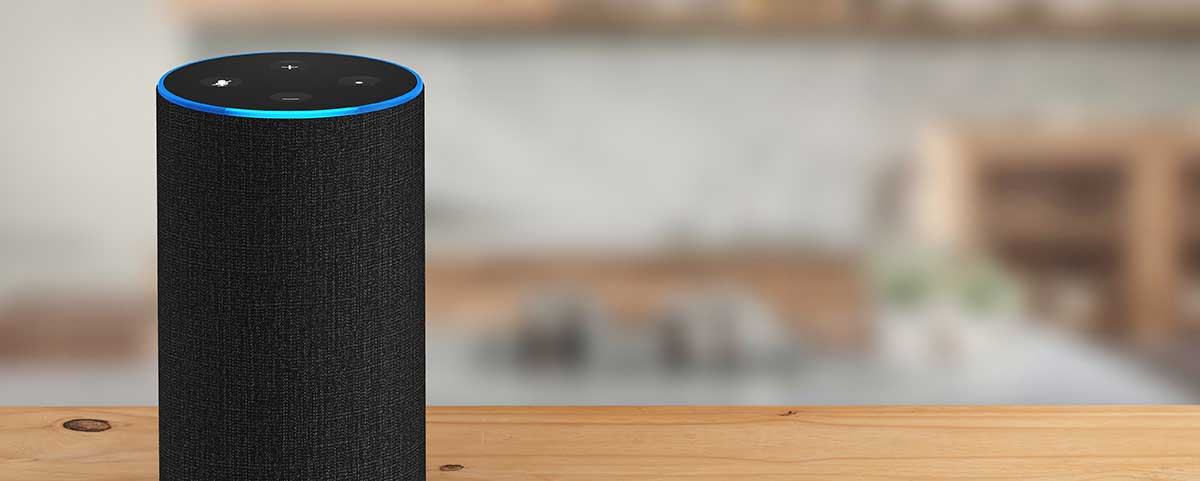 An image of an Amazon Echo personal voice assistant on a kitchen counter